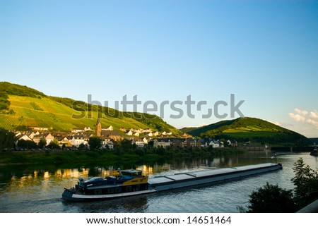 beautiful village with vineyards and forest along the mosel river in germany - stock photo