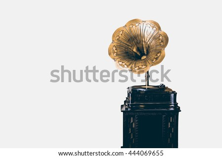 Beautiful vintage gold gramophone isolated on white background, filtered color tone - stock photo