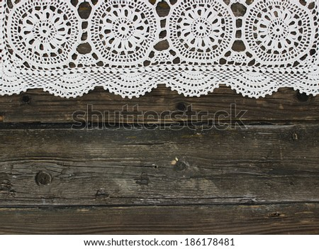 beautiful vintage knitted lace on wooden background - stock photo