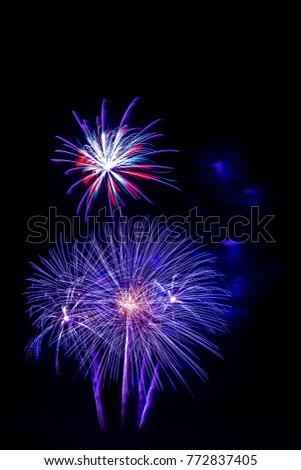 beautiful violet blue firework isolated display for celebration happy new year and merry christmas on black isolated background, fireworks new year