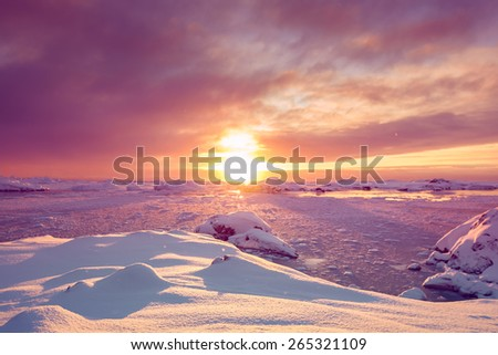Beautiful violet snow-capped mountains against the blue sky in Antarctica. Vernadsky Research Base. - stock photo