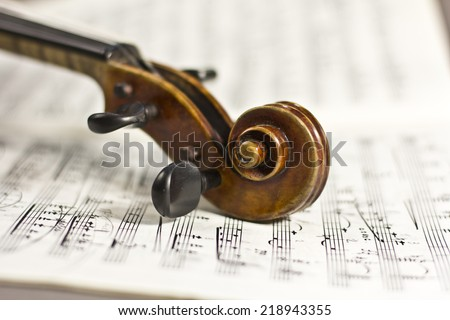 beautiful violin on a background of the old notes. musical instruments. stringed instruments - stock photo