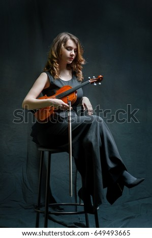 Beautiful violinist girl with violin