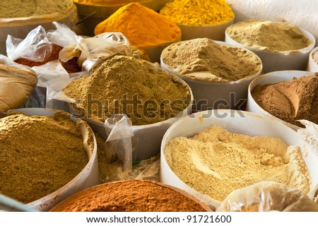 Beautiful vivid oriental market with baskets full of various spices - stock photo