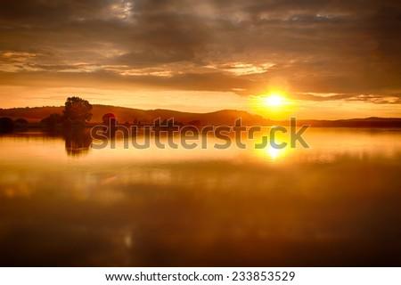 Beautiful vivid sunset over the lake Labut (Swan), Czech republic. HDR - stock photo