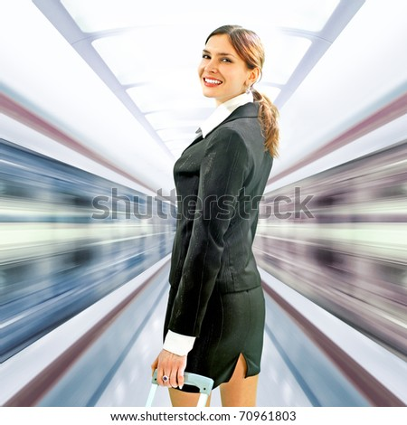 beautiful voyager has looked back on platform in underground - stock photo