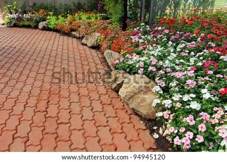 Beautiful walkway winding its way through a tranquil garden - stock photo