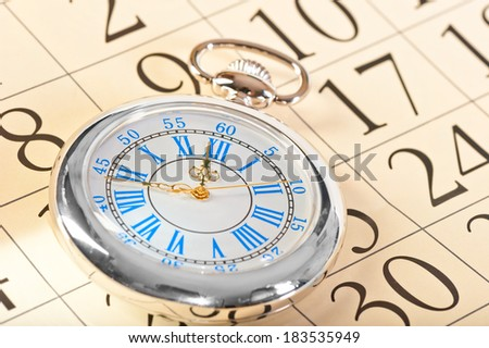 beautiful watch with blue clock face and gold hands - stock photo