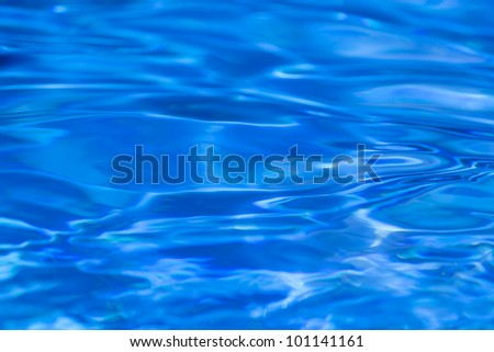 Beautiful water reflection and ripples on pool - stock photo