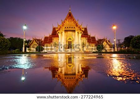 Beautiful water reflection of Wat Benjamaborphit or Marble Temple at twilight in Bangkok, Thailand - stock photo