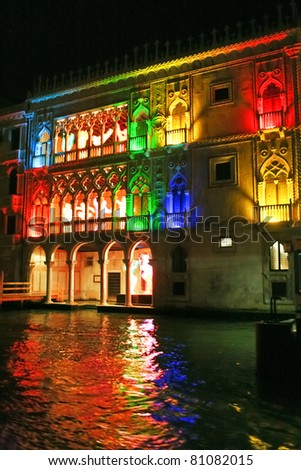 Beautiful water street at night time in color lights in Venice, Italy - stock photo