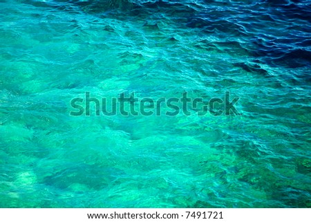 Beautiful water surface on the beach - stock photo