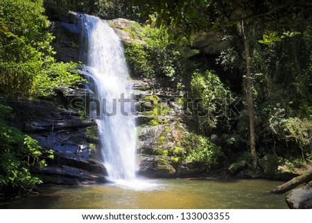Beautiful waterfall and fast flowing rapids in Ranomafana rainforest of Madagascar. - stock photo