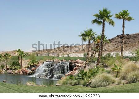 Beautiful waterfall and palm trees - stock photo