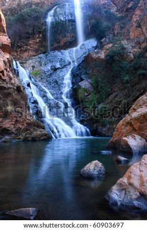 Beautiful waterfall and pool - stock photo