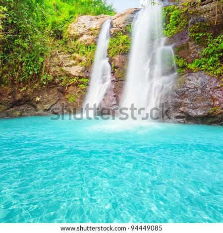 Beautiful waterfall at summer sunny day. - stock photo