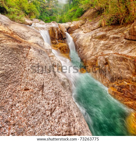 Beautiful waterfall at summer sunny day. Vietnam - stock photo