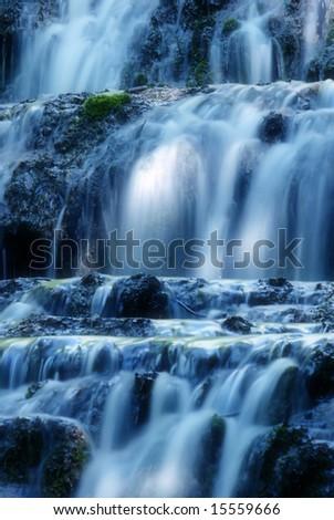 Beautiful waterfall, blue toned, long exposure - stock photo