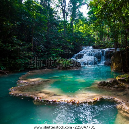 Beautiful waterfall. Deep forest Waterfall. - stock photo