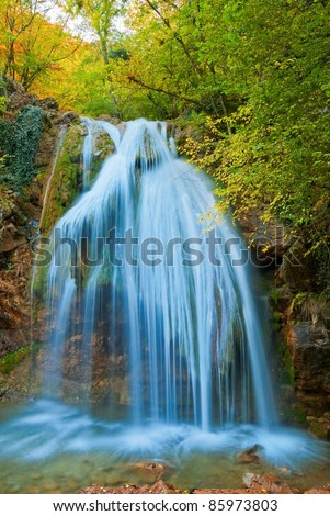 beautiful waterfall in a mountains - stock photo