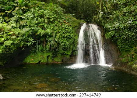 Beautiful waterfall in a rainforest. Cascades aux Ecrevisses, Guadeloupe, Caribbean Islands, France - stock photo