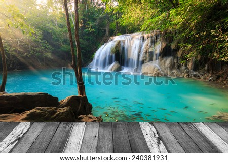 Beautiful waterfall in deep forest and wood pier at Kanchanaburi, Thailand