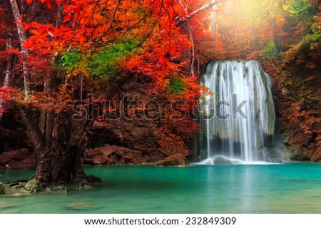 Beautiful waterfall in deep forest, Erawan National Park in Kanchanaburi, Thailand - stock photo