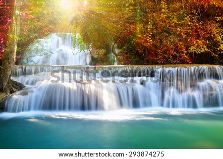 Beautiful waterfall in deep forest with sun light  - stock photo