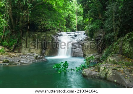 Beautiful waterfall in forest - stock photo
