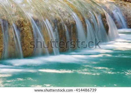 beautiful waterfall in green forest in jungle at phu tub berk mountain , phetchabun , Thailand - stock photo