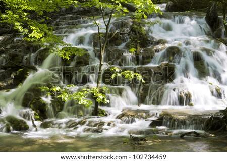 Beautiful waterfall in Nerei Canyon area, Romania - stock photo