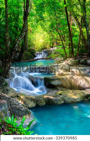 Beautiful waterfall in Thailand tropical forest - stock photo