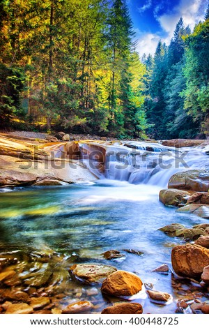 Beautiful waterfall in the forest,  fresh water flows between stones and rocks, wonderful landscape, wild nature's beauty of Ukraine - stock photo