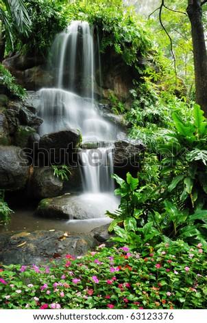Beautiful waterfall in the garden - stock photo
