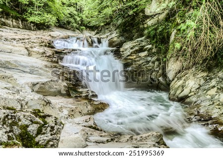 Beautiful waterfall in the Navarra forest. Amazing image with motion effect on the water. The picture is with high resolution and clean details for many manipulations.