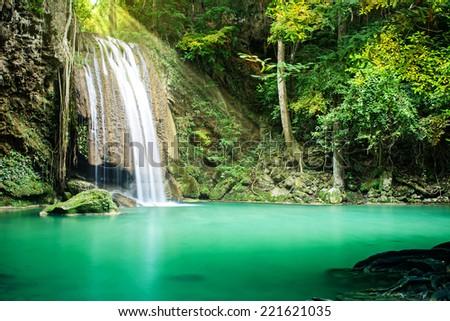 Beautiful waterfall in tropical forest, Erawan waterfall, Thailand  - stock photo