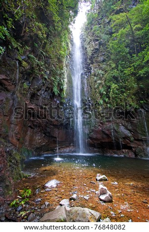 beautiful waterfall on madeira island, portugal - stock photo