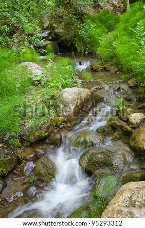 beautiful waterfall on small forest stream - stock photo