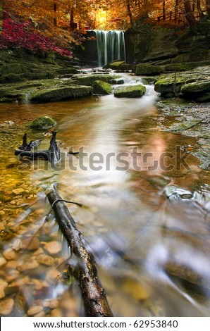 beautiful waterfall with autumnal colours - stock photo