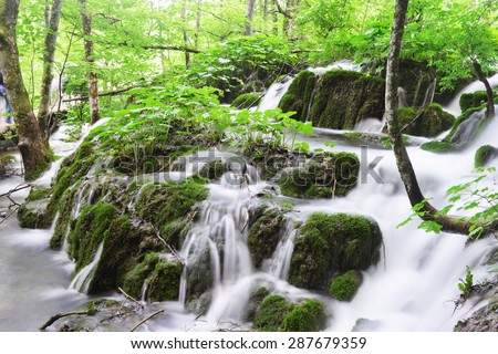 beautiful waterfalls on slopes of mountains