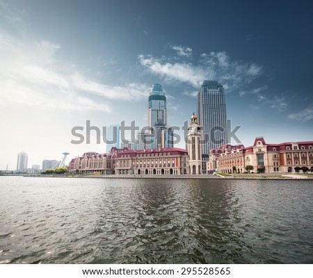 beautiful waterfront city against a blue sky in tianjin - stock photo