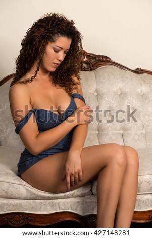 Beautiful wavy haired multiracial woman in a denim bustier