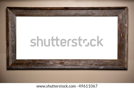 Beautiful weathered and worn wood frame hanging on wall. Interior decor element with blank copy space for your text or image.