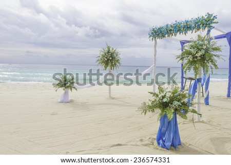 beautiful wedding arch, cabana, beach wedding, tropical wedding set up - stock photo