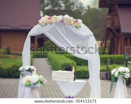 beautiful wedding arch for the ceremony of flowers. Retro color