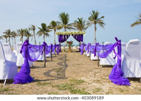 Beautiful wedding arch on the beach  - stock photo