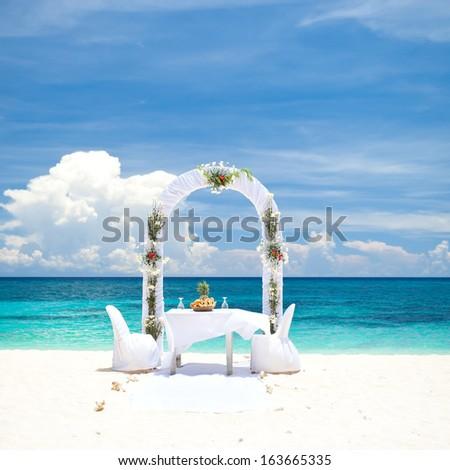 Beautiful wedding arch on tropical beach, nobody. Travel wedding - stock photo