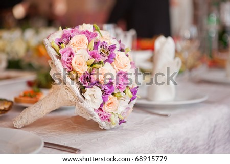 beautiful wedding boquet lying on table in restaurant - stock photo