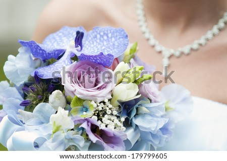 beautiful wedding bouquet and bride - stock photo
