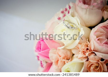 Beautiful wedding bouquet and wedding rings  - stock photo